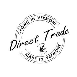 """A circular graphic with the phrase Direct-Trade in the center. Surrounding that is the phrase """"grown in vermont, made in vermont"""""""